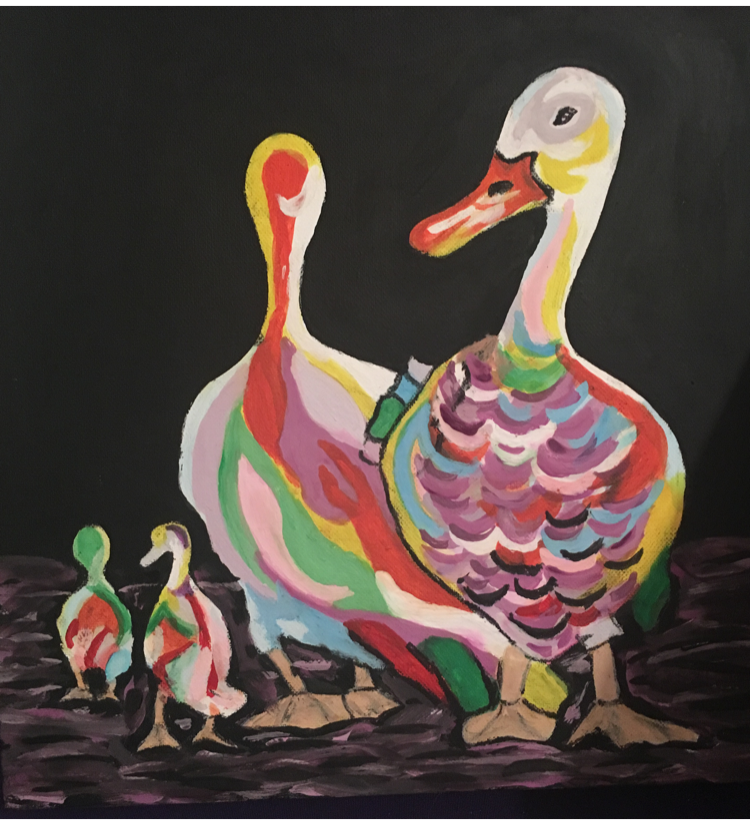 Multi coloured geese family